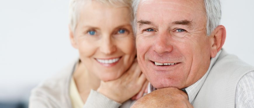 Charming old couple smiling together